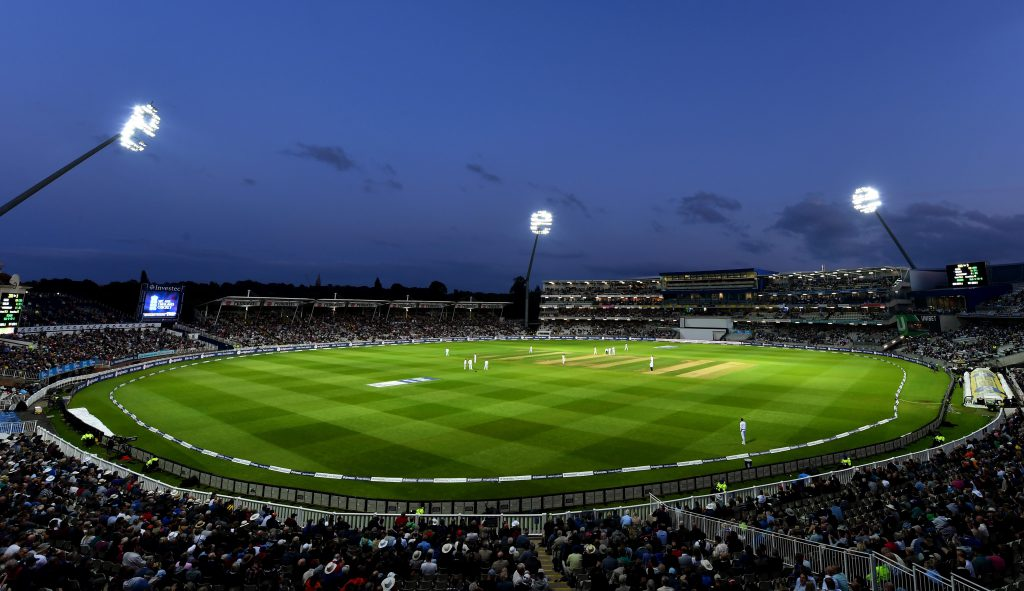Cricket pitch with floodlights.